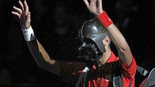 Novak Djokovic arrives on court wearing a Darth Vader mask