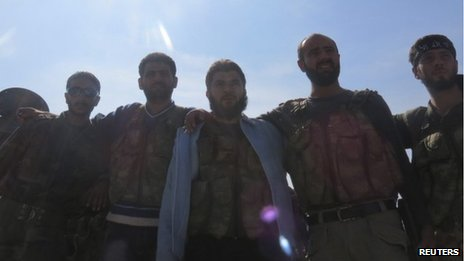 Free Syrian Army fighters gather after defeating government troops at Salqin city near Idlib October 29, 2012.