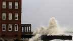 Waves break on a battered house on the Atlantic City seafront.
