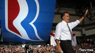Republican presidential nominee Mitt Romney takes the stage at a campaign rally in Coral Gables, Florida 31 October 2012