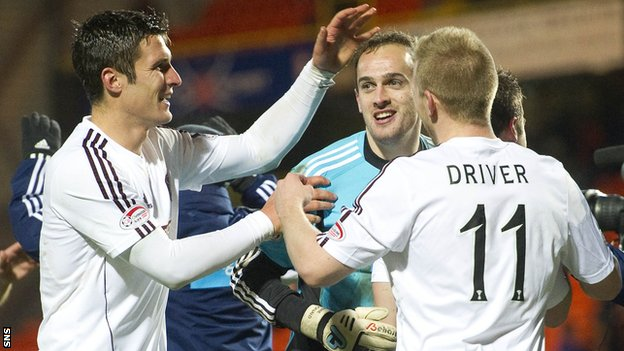 Hearts goalkeeper Jamie MacDonald is congratulated by John Sutton and Andy Driver