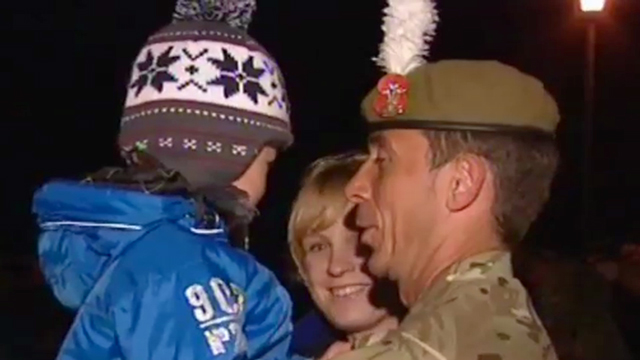Soldier greets his family