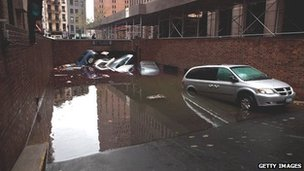 Cars floating in a flooded basement in the Financial District of New York