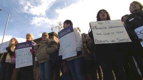 Female hospital workers holding placards in protest