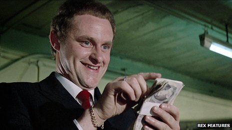Clive counting money in a scene from The Italian Job