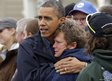 Barack Obama, left, embraces Donna Vanzant, right
