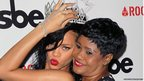 Recording artist Rihanna (L) and mother Monica Braithwaite