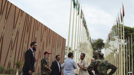 Security members meet spokesmen representing ex-revolutionary militia groups in front of the General National Congress building in Tripoli, November 1