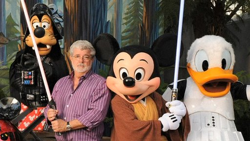 George Lucas with a group of Disney characters
