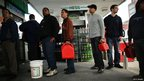 People wait in line for petrol in New York, New York 1 November 2012