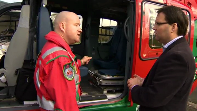 A paramedic shows Owain Clarke inside the new air ambulance