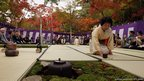 A ceremony master prepares green tea during an outdoor tea ceremony at Zuihoji Temple Park