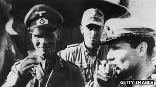 Erwin Rommel (left) drinks a toast with his men before the battle of El Alamein