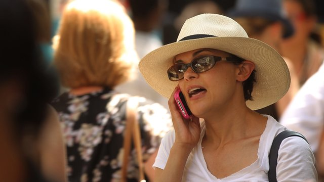 A woman speaks on her mobile phone