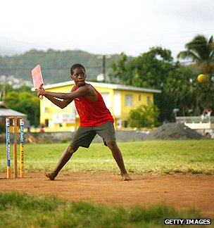 A child plays cricket on one of the many local pitches on March 4, 2007 in Kingston, Saint Vincent.