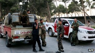 Libyan security forces stand guard near the parliament building in Tripoli, 2 November 2012