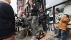 A man rides a stationary bicycle to generate power to charge mobile devices for free to residents in Manhattan's East Village, 1 Nov 2012