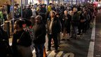 People line up on a Manhattan street to take buses back to Brooklyn, 1 Nov 2012
