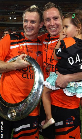 Besart Berisha and Matthew Smith celebrate Brisbane Roar&#039;s A-League Grand Final win over Perth Glory