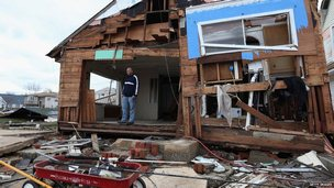 A man stands outside his home in Lindenhurst, on the southern shore of Long Island. Photo: 31 October 2012