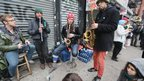 "Members of the Rude Mechanical Orchestra perform an impromptu jam session on the Avenue C shortly after power was restored in Manhattan""s East Village on November 2, 2012 in New York City"