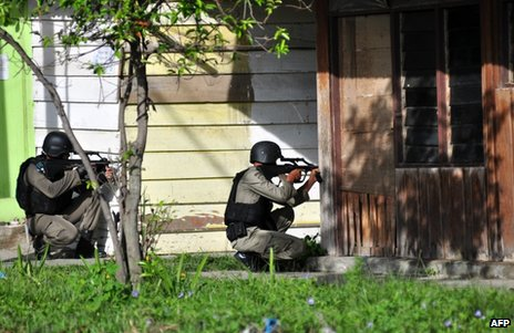 Indonesian anti-terror police take aim in Poso, Central Sulawesi province, 3 November