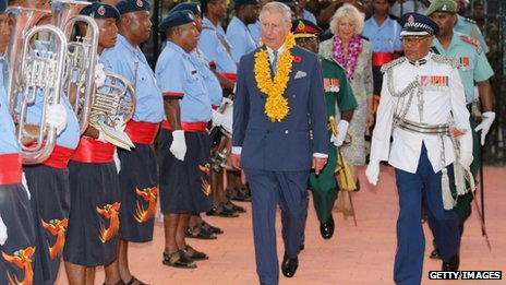 The Prince of Wales inspects a guard of honour as the Duchess of Cornwall looks on at Jacksons International Airport, Papua New Guinea