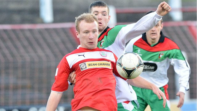 Liam Boyce of Cliftonville and Mark Clarke of Glentoran