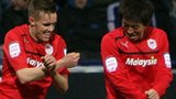 Craig Noone celebrates his opener for Cardiff with Kim Bo-Kyung