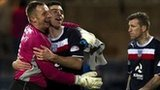 Goalkeeper Rab Douglas congratulates defender Declan Gallagher