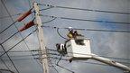 Repair man on power lines, Staten Island, New York (3 November)