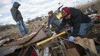 Residents pick through debris, Staten Island, New York