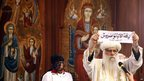 The Church's acting leader, Bishop Pachomius, shows the ballot bearing the name of Bishop Tawadros in Arabic