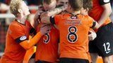 Dundee United scored two late goals to grab a share of the points at Tannadice