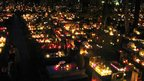 Thousands of candles glowing in the dark in Krakow's main cemetery on All Saints Day. Photo: David McGirr