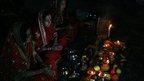 Indian women praying. Photo: Abhisek Saha
