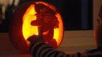 Pumpkin carved as Postman Pat. Photo: Simon Gittins