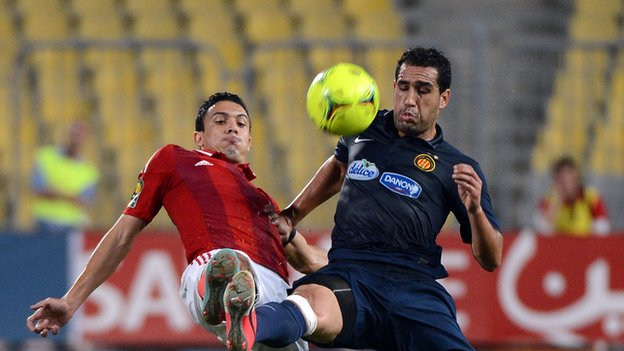 Al-Ahly player Mohamed Nagui (left) vies for the ball with Sameh Derbali of Esperance