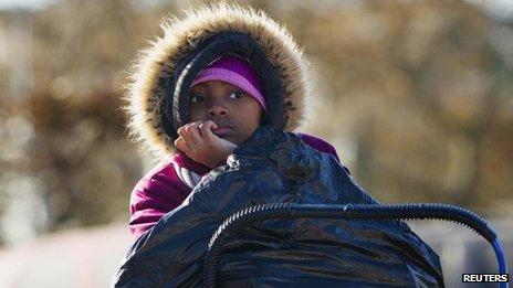 Girl watches over donated bag of clothing, Rockaways, Queens, New York (4 November)