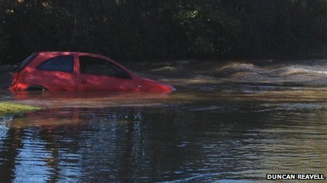 Car stuck in flood water
