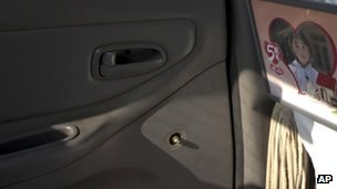 A window handle on the door at the back seat has been removed from a Beijing taxi, 1 Nov 2012