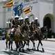 Zimbabwean guards on horseback, holding flags, outside parliament in Harare - Tuesday 30 October 2012