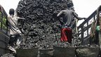 A truck full of charcoal being unloaded in Mogadishu, Somalia  - Tuesday 30 October 2012