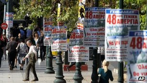 Posters advertise a 48-hour strike in Greece