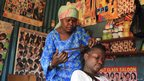 A hairdresser and her client in Nairobi, Kenya -  - Wednesday 31 October 2012