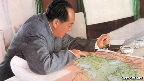 retouched picture of the leading theorist of the Chinese communist revolution, Chairman of the Party and President of the Republic Mao Zedong reads a map in his private train compartment in 1963.