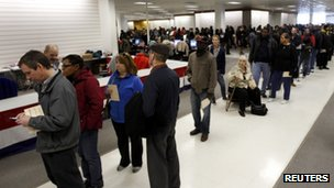 Voters wait in line to cast their ballots at the Franklin County in-person absentee voting location in Columbus, Ohio 5 November 2012