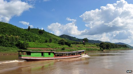 Mekong river boat in northern Laos, near the Thai border
