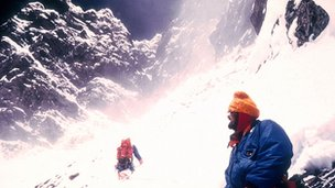 Chris Bonington and Doug Scott moving up towards the rock band above camp 5 at 27,000 ft, on Everest in 1975