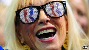 A woman wears Romney sunglasses at a rally in Fairfax, Virginia 5 November 2012